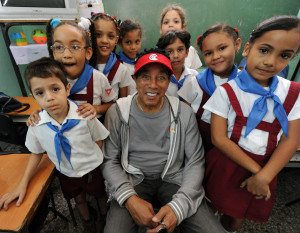 Smokey Robinson poses with children at Manuel Fernandez Roig School.